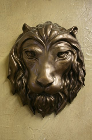 Bas Relief of a lions head by Ohio Artist Terri Meyer