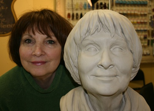 peg vasil with portrait sculpture