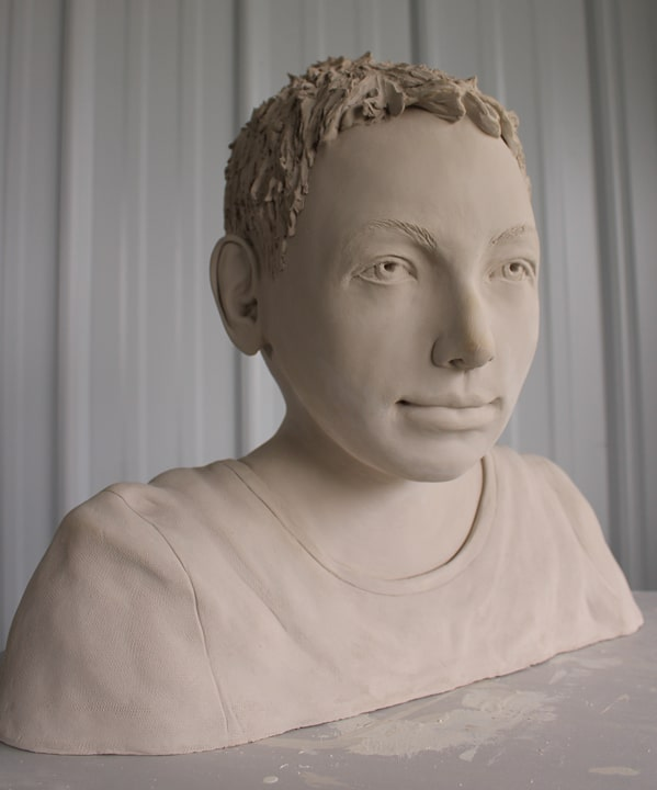 Portrait sculpture of a boy